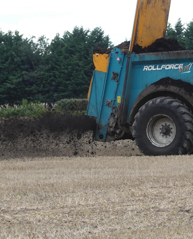 Farmer spreading compost